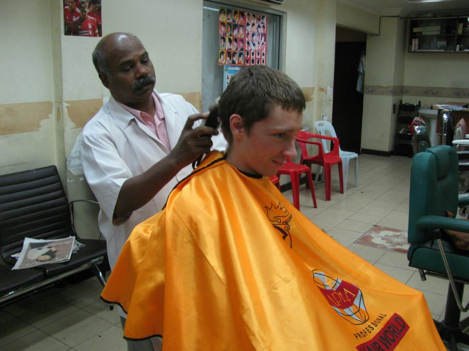 You might nervously go to a $5.00 barber in little India.